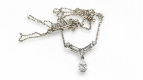 A Diamond And White Gold Necklace