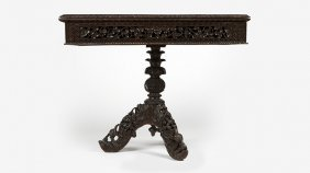 An Anglo-indian Carved Wood Flip-top Game Table