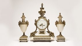 A French Bronze And White Marble Mantel Clock Set