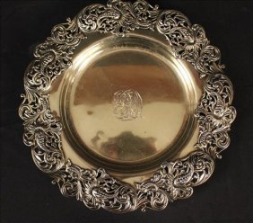 Heavy sterling tray with ornate scroll work on rim