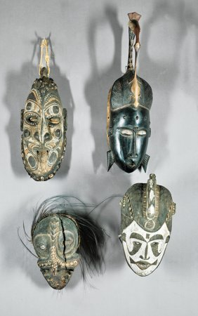 Four African And/or Oceanic Carved Wood Masks