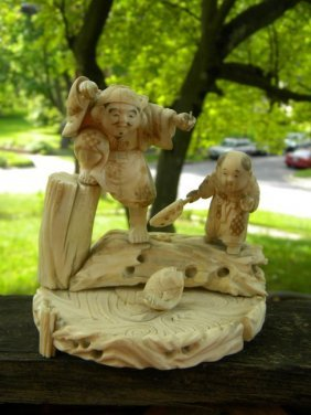 Antique Carved Statue Fishing Scene