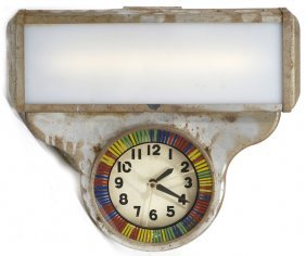 1930'S NEON SPINNER METAL CLOCK