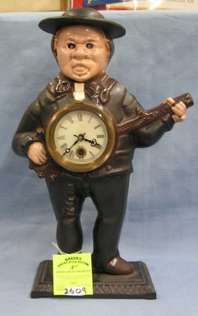 Cast Iron Banjo Player Blinking Eye Clock