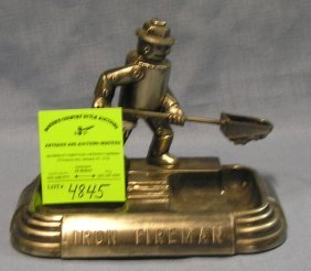 Antique Iron Fireman Figure