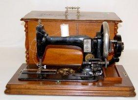 Antique Walnut Cased Sewing Machine
