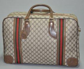 A Gucci Vintage Monogram Canvas Leather Travel Bag