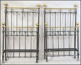 PAIR OF BRASS AND PATINATED METAL BEDS.