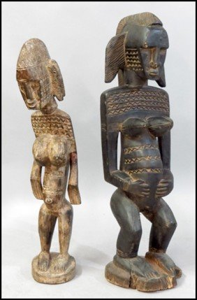 TWO AFRICAN CARVED WOOD FERTILITY FIGURES.