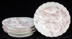 SET OF FOUR CONTINENTAL PAINTED AND GILT PORCE