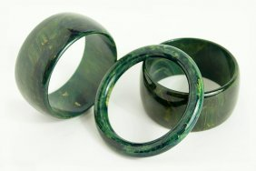 A Pair Of Spinach Green Mottled Bakelite Bangle