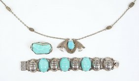 An Egyptian Revival Turquoise Paste And Silvertone