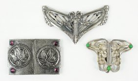 A Group Of Three Art Nouveau Ribbon Buckles.