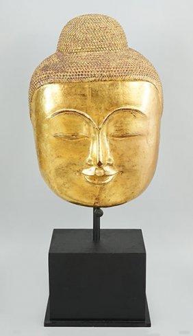 A Gilt Papier Mache Buddha Mask.