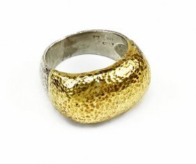 A Yellow Gold And Sterling Silver Ring.