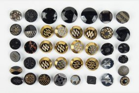 A Collection Of Twelve Gilt Carved Glass Buttons.