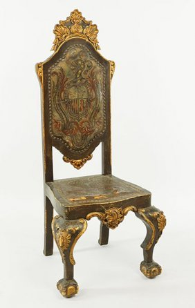 A Continental Carved Wood Chair.