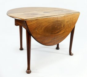 An English Queen Anne Style Mahogany Drop Leaf Table.