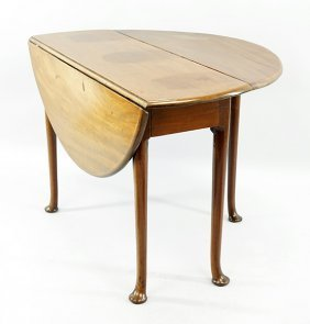 A Queen Anne Style Mahogany Drop Leaf Table.