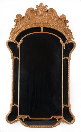 A French Style Lacquered And Gilt Wood Mirror.
