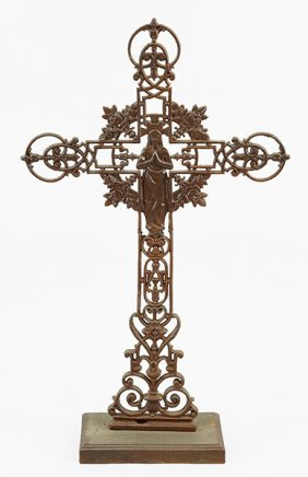 A Patinated Metal Crucifix.