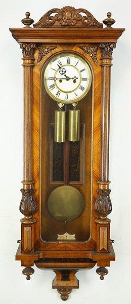 A Carved Walnut Regulator Clock.