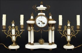 A French Portico Clock And Garniture.