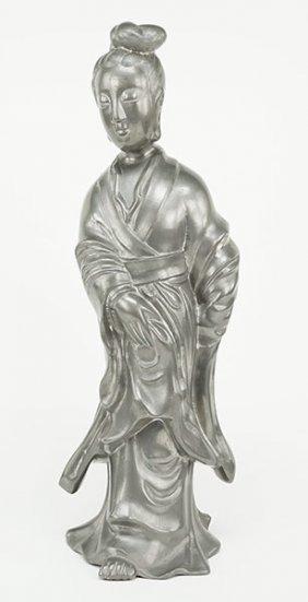 A Patinated Metal Figure Of Quan Yin.