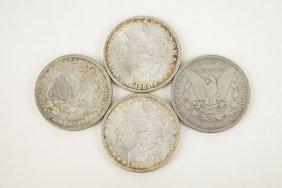 Four Morgan Silver Dollars.