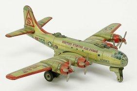 A Japanese Yonezawa Tin Friction Bomber Airplane.