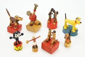 A Collection Of Wood And Plastic Push Puppets.