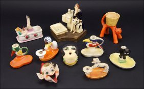 A Collection Of Art Deco Figural Ashtrays And Match