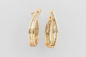 Pair Of 14 Kt Hoop Gold Earrings With Diamonds