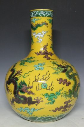 A Yellow Ground Famille Rose Bottle Vase