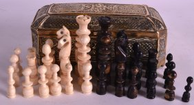 An Early 19th Century European Carved Bone Chess Set