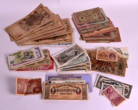 A Collection Of Various Bank Notes Including America,