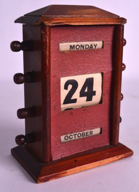 A 1930s Oak Desk Calendar. 7ins High.