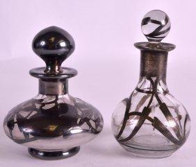 A Pair Of Art Nouveau Silver Overlaid Scent Bottles