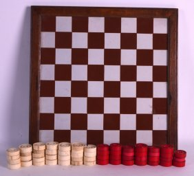 A Mid 19th Century Carved European Ivory Draughts Set