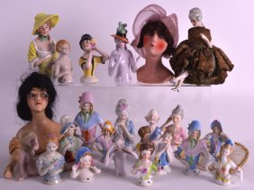A Collection Of Art Deco Porcelain Dolls In Various