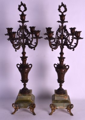 A Pair Of 19th Century French Onyx And Gilt Candleabra.
