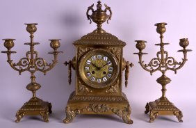 A 19th Century French Brass Clock Garniture With Well
