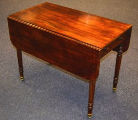 A George Iii Mahogany Pembroke Table With Drop Sides