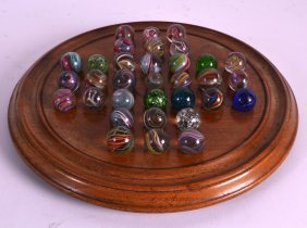 A Rare Set Of Antique Double Cased Mica Marbles With