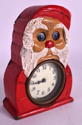 A Rare Painted Novelty Clock In The Form Of Father