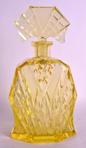 A French Art Deco Yellow Perfume Bottle And Stopper