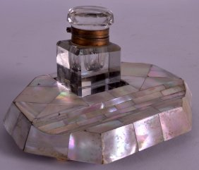 A 19th Century Mother Of Pearl Inkwell With Pen Rest.