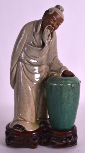 A 19th Century Chinese Pottery Model Of A Scholar