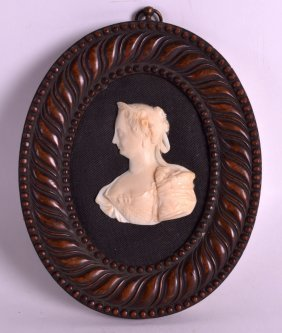 A Mid 19th Century European Carved Ivory Portrait