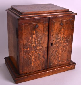 A 19th Century Carved Walnut Desk Cabinet With Two